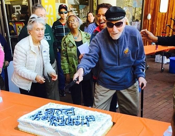 Bob Simon cuts the cake celebrating his 101st birthday on April 11, 2015.