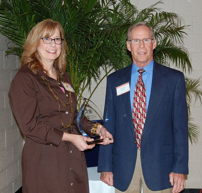 2014 H. Gordon Randall Outstanding Volunteer Kay Bransford with MCC Executive Director George Sachs.