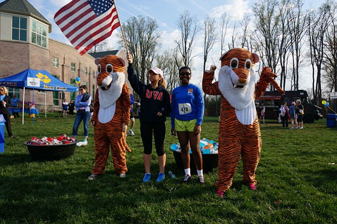 Holy Child tigers were joined last year by then freshman Kendall Soistman and then junior Tahana Augustin, who also sang the national anthem at this 2014 Tiger Trot 5K.