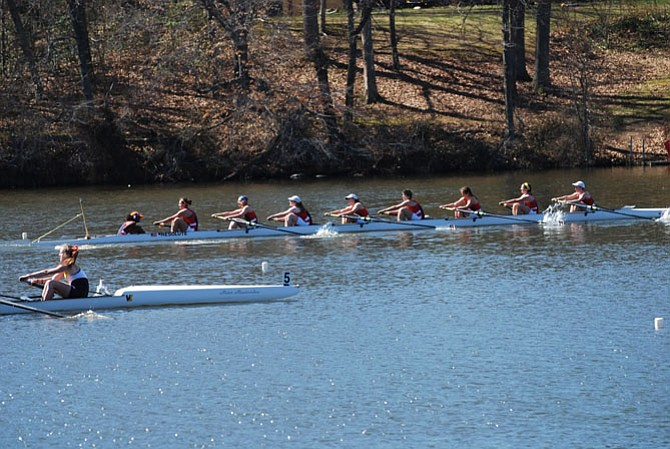 The T.C. Williams girls' first 8 sprints down the course, capturing first place and retaining the Ward Wallace Cup, a trophy for the annual race between T.C. Williams and St. Andrew's. Members include Brooke Teferra (coxswain), Maria Justiano, Claire Embrey, Katie Murphy, Reed Kenney, Amelia Bender, Maura Nakahata, Maeve Bradley and Kyra McClary.