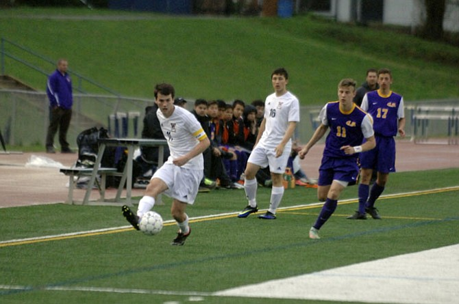 Woodson senior Zach Yaglou (11) scored a goal in the first half of Tuesday's match against Lake Braddock.