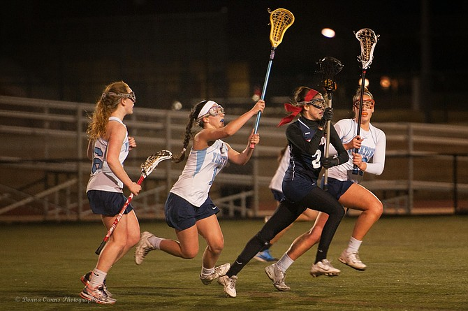 Yorktown players Emma Thurman, Laura Crawford and Kaleigh Day defend against Edison on March 23.