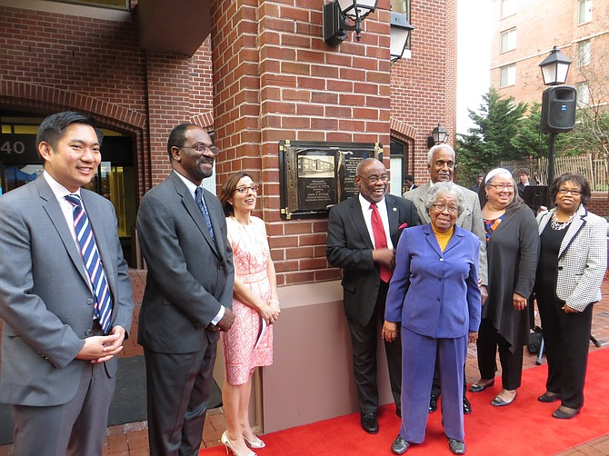 From left: Anthony Chang, senior director of Asset Management for Washington REIT; Alvin Crawley, superintendent of schools; Karen Graf, chair of the Alexandria City School Board; William Euille, mayor of Alexandria; Lovell Lee, former president of the Parker-Gray High School Alumni Association; Alice Thompson, president of the Parker-Gray High School Alumni Association; Aubrey Davis, director of the Black History Museum; and Brenda LaVere Elliott, chair of the 1964 Parker-Gray Reunion.
