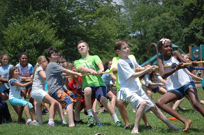 Summer camp experiences can help children become self-confident and self-reliant.