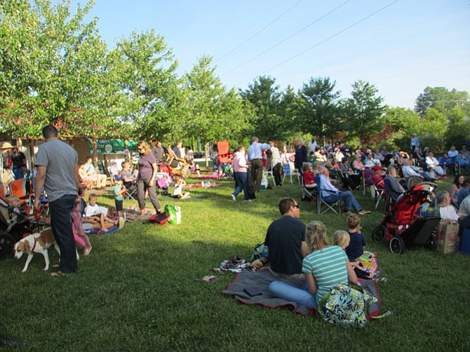 Friday and Sunday evenings, the Town Green fills with families and friends who come for live music on the stage there.