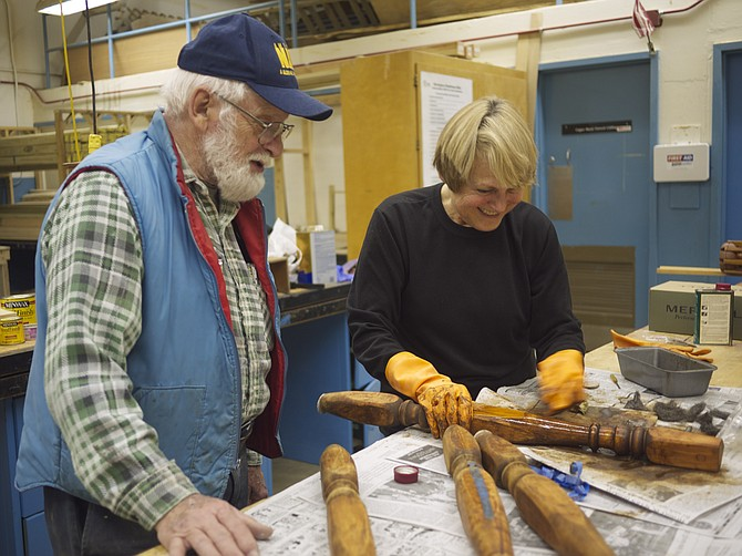 Paul Dietz teaches woodworking to Carolyn Ryffel at the Career Center.