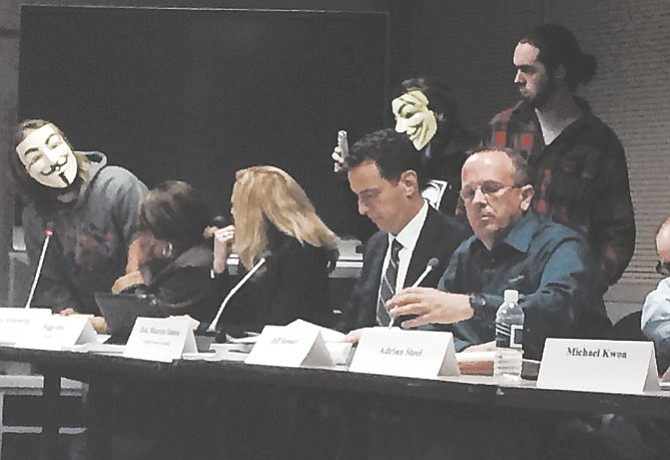 A masked community member (left) spoke near the end of the April 27 Ad Hoc Police Practices Review Commission meeting. He asked Captain Bob Blakely, Detective Chris Flanagan and Commonwealth's Attorney Raymond F. Morrogh about use of tear gas and pepper spray by police being considered deadly or non-deadly force.