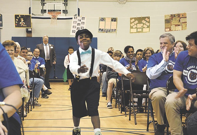 Current Burke School student Jayon Knight displayed a number of classic elements of school attire from decades ago during a fashion show for the Burke School 75th anniversary celebration.