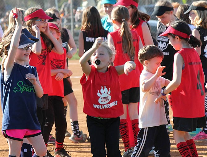 Softball players and children enjoy the opening day festivities.