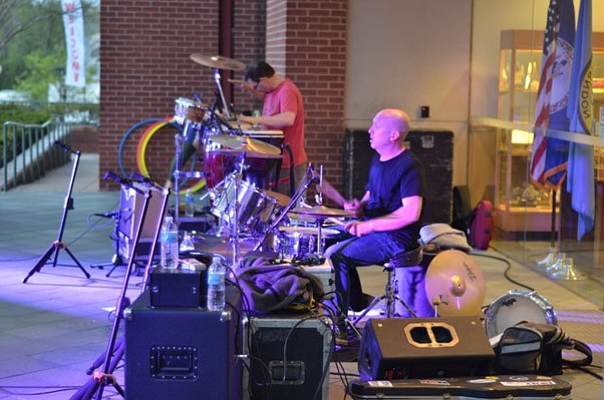 Musicians Paul Voshell on the drums and David James handled percussions at the May 2, 2014, Friday Night Live Concert at the Town of Herndon.