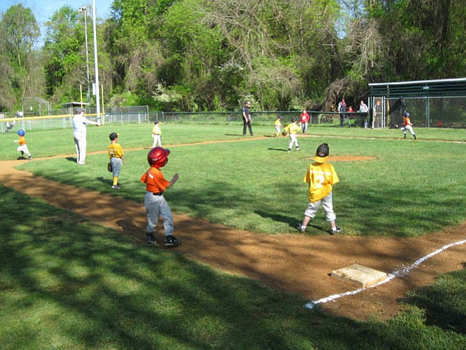 No scores are kept in the Little League T-Ball game between the Hotrods and the Grasshoppers at Howery Field #2 in Annandale last Saturday.