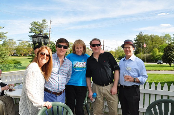 From left are Cassie Harwood and Jonathan Neal with Metropolitan Moving & Storage; Jill Phillips with Squeals on Wheels; Adam Greenberg with Potomac Pizza; and Steve Lorberbaum with Assisting Hands Home Care.