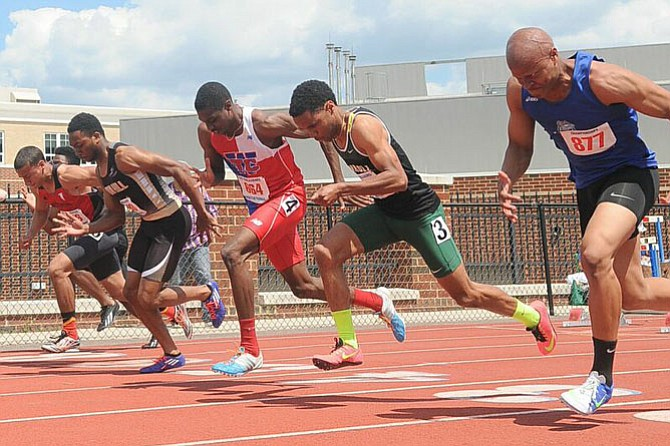 T.C. Williams junior Noah Lyles, third from right, won the 100-meter dash at the T.C. Williams Invitational on May 2.