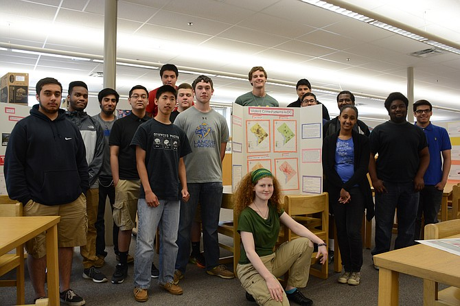 Robert E Lee High School seniors in Mary Schaefer's Geospatial Analysis class, including (rear, from left) Hammad Chaudhry, Timothy Freeman, Hasan Ali, Sothea Sok, Enzo Rodriguez, Jia-Kang Ju, Brian D'Amore, Cameron Smith, Peter Block, James Zurta, Mirza Baig, Solomon Araya, Bilien Woldetatios, Samuel Amarteifio, Alexis Arriaza and (front) Sunny Cushing-Spiller presented mapping projects at the National Geospatial-Intelligence Agency in Springfield.