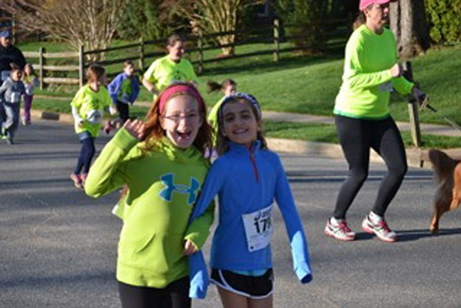 Riley Lynch and Mary Boniface on the course. More than 200 Wolftrap Elementary students participated in the event.