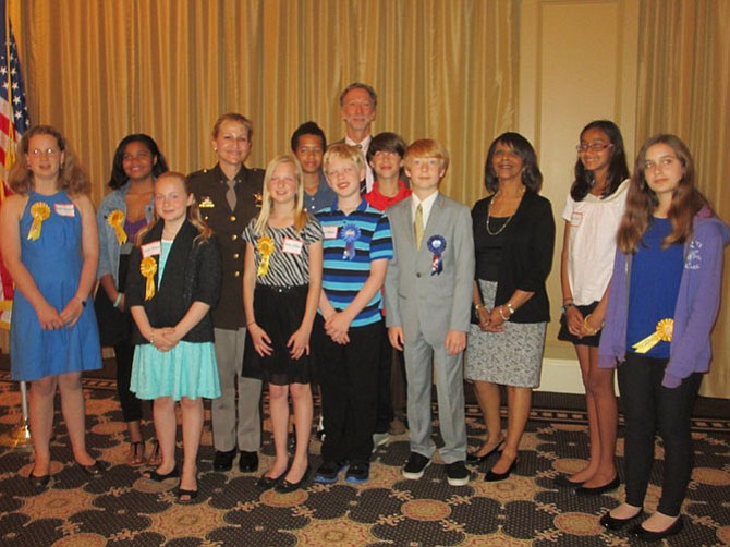 From left -- front row: Susan Weinhardt, Adison Verena, Abby Williams, Ethan Uffelman, Tyler Bechtle, Helping Hands Coordinator Pat Hackerson, Sonia Naik, and Michael Wacht. Back row: Cantara Harris, Fairfax County Sheriff Stacey Kincaid, Nicholas Yancy, Vienna Optimists president Richard Gongaware, and Hunter Moss. Not present is Kevin Molina Benitez.