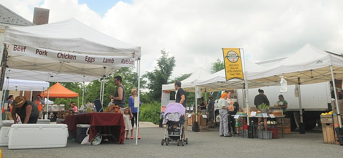 Fourteen producing vendors within a 120-mile radius of the Fairlington Community Center participate in the Sunday market.
