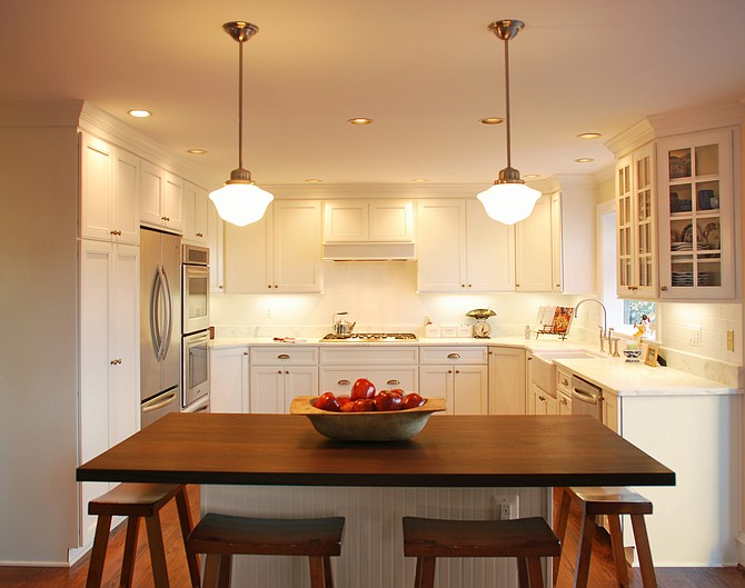 A kitchen with a walnut-topped island accommodates an Arlington couple's penchant for entertaining.