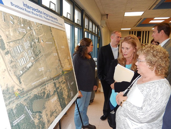 Tami Troscianecki (left) and Sandi Croan look at a diagram of the project area.