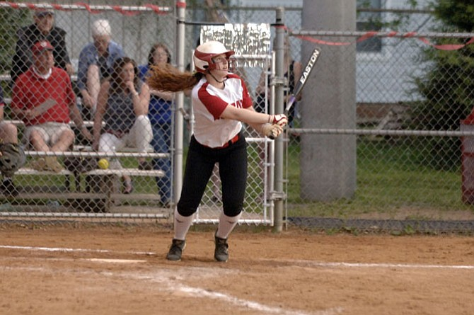 McLean senior Erin Calpin launches a walk­-off home run against Madison on May 8. The Highlanders won 1-0 on senior night.