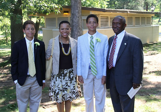 Melvin Miller with daughter Ericka and twin grandsons Zachary and Bennett at a recent school graduation.