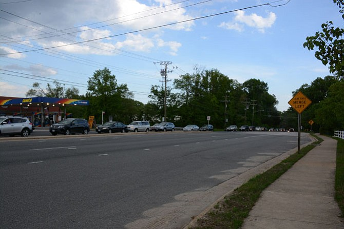 Cars heading northbound on two lanes of Rolling Road back up during a weekday evening rush hour.