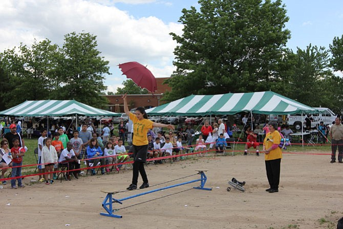 The Jim Moyer Circus Club performs at the 2014 Hope & Health Festival in Lorton.