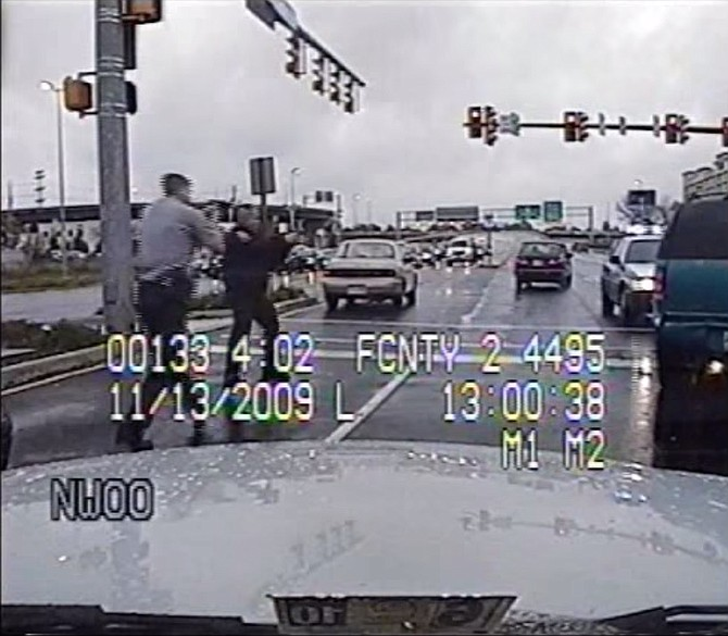 The dashboard-mounted camera in Fairfax County Police officer David Scott Ziants' cruiser shows Ziants and another officer approaching David Masters' Chevrolet Blazer with guns drawn.