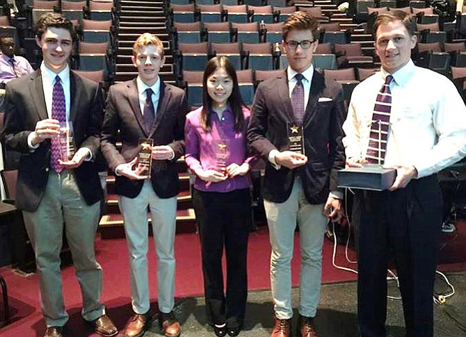 Holding their trophies are (from left) Brendan Aronhime, Kincaid Youman, Alice Wang and Aron Malatinszky with their coach, Joe Clement.