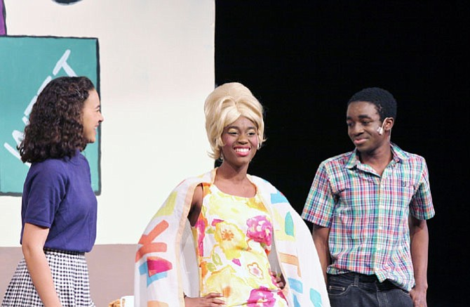 From left:  Sydney Crutcher, Amirah Kirwan and Nathan Nkomba in South Lakes High School's production of 'Hairspray.'