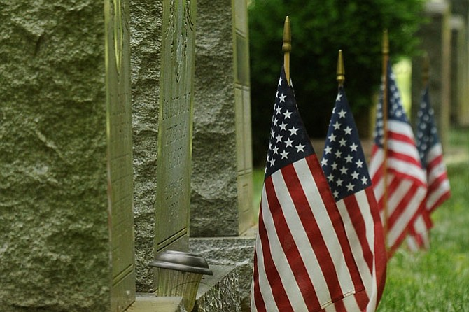 Volunteers organized by the Ivy Hill Cemetery Historical Preservation Society decorated the headstones and grave markers of 661 veterans with flags last Sunday.