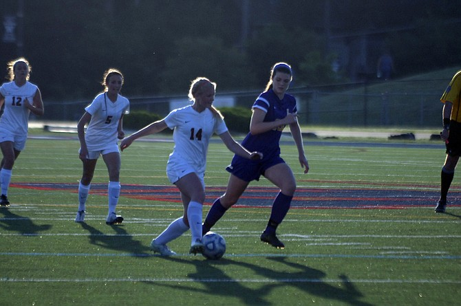 Woodson forward Natalie Stynchula (14) scored her team-leading 15th goal of the season on Tuesday during a 2-1 victory over Lake Braddock.