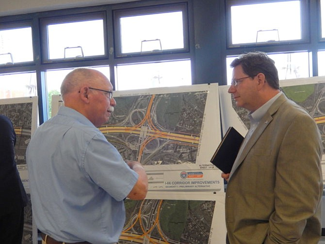 Jerry Foltz (left), of Centreville's Country Club Manor community, and VDOT engineer Mitch Ball discuss the I-66/Route 28 project.