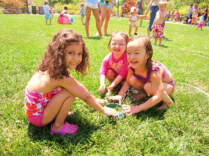 Stories and sprinklers on the Town Green draw younger children on hot, steamy days.