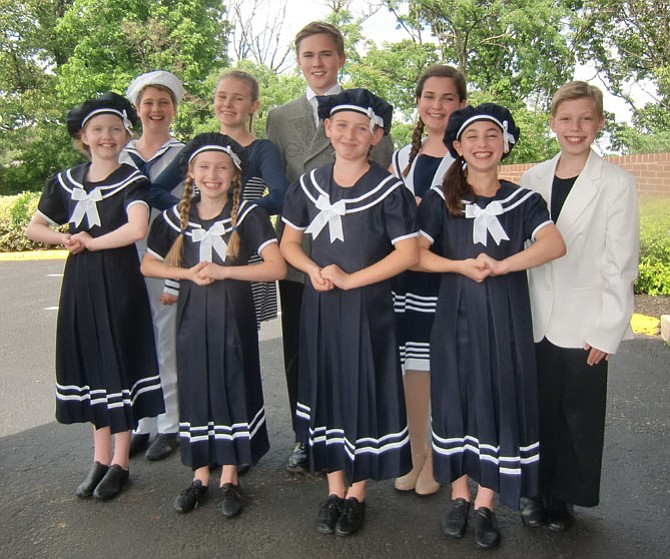 The family von Trapp includes, from left, first row, Allison Howlett (Louisa), Emily Ashman (Gretl), Madison Sherman (Brigitta), Olivia Putnam (Marta), second row, Daniel Schorr (Friedrich), Alisa McCaw (Maria), Timothy Proudkii (Captain), Ayelet Baisburd (Liesl), and Eli Langer (Kurt). Not pictured are double cast members Alexa Vinner (Gretl) and Rachel Roberts (Marta).