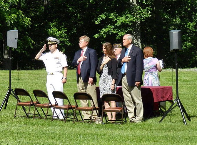 From left, U.S. Navy Capt. Matthew Kosnar, supervisor John Cook (R-Braddock), Del. Eileen Filler-Corn (D-41), Veterans of Foreign Wars Post 5412-Burke Commander Scott Logan and State Sen. Dave Marsden (D-37) led a Memorial Day ceremony at Burke Centre Conservancy.