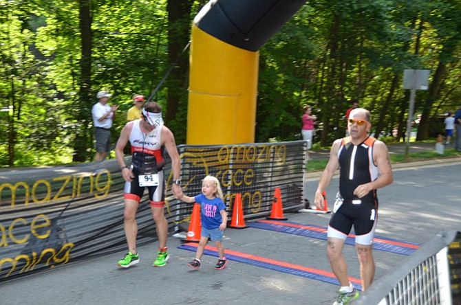 Sterling resident Ryan Albrecht crossed the finish line with his daughter. The Reston Sprint Triathlon event included 15 miles of swimming, biking and running.