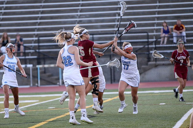 Oakton senior Karlie Cronin attacks the goal while Centreville's Caroline Kelly (17) defends during Saturday's 6A North region semifinal contest at Centreville High School.
