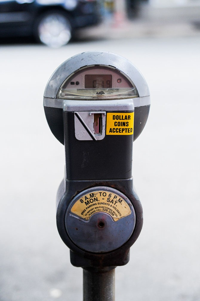 Parking meter in Clarendon with current parking hours listed.