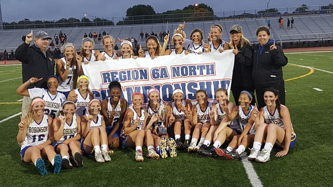 The Robinson girls' lacrosse team won the 6A North region championship on June 2 with a 15-6 victory over Oakton at Robinson Secondary School.