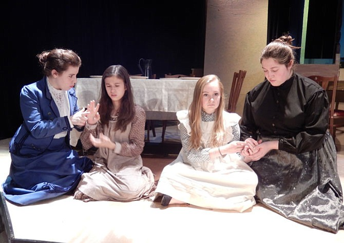 Teaching the alphabet: Double cast as Annie are (far left) Abby Rozmajzl and (far right) Sarah Giuseppe, with (in middle, from left) Isabella Whitfield and Meghan Kelly as Helen Keller.