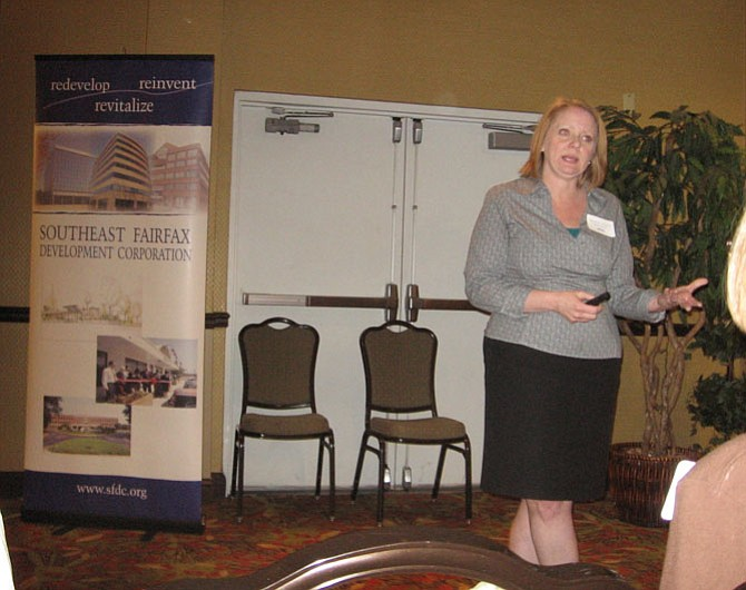 Heather Arnold of Streetsense speaks to attendees at the Retail Summit sponsored by the Sutheast Fairfax Development Corporation at the Hampton Inn & Suites on June 2.