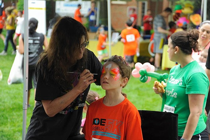 The colorful face-painting at The Joe Cassella 5K Post-race Party is always the most popular tent featured in Kids Corner.