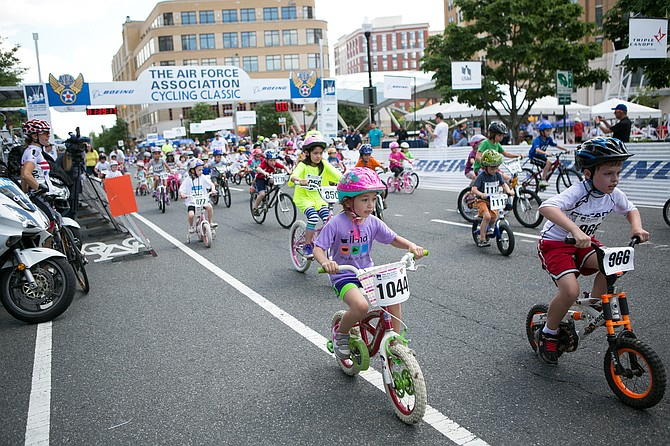 Children race in the 2014 Kids Bike Race dedicated to Ethan Kalancnik.