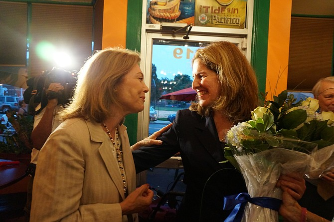 Vice Mayor Allison Silberberg, right, is congratulated by a supporter at Los Tios Restaurant following her victory in the June 9 Democratic primary. Silberberg defeated incumbent Mayor Bill Euille and former Mayor Kerry Donley in the race to determine the Democratic candidate for mayor in November's election. At this time, she is running unopposed.