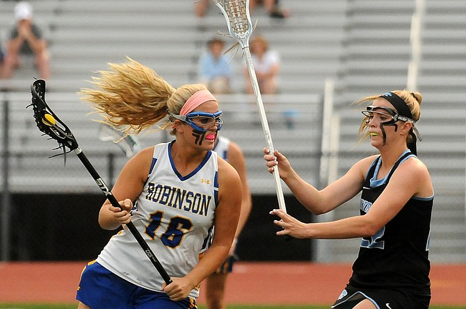 Centreville senior Caroline Wakefield, right, defends Robinson junior Kaitlin Luccarelli during the 6A state semifinals on Tuesday at Robinson Secondary School.