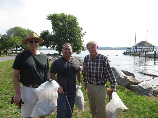 Howard Bergman, Jeff Linsky, and Greg Golubin clean up the Waterfront with the Founder's Park Community Association.