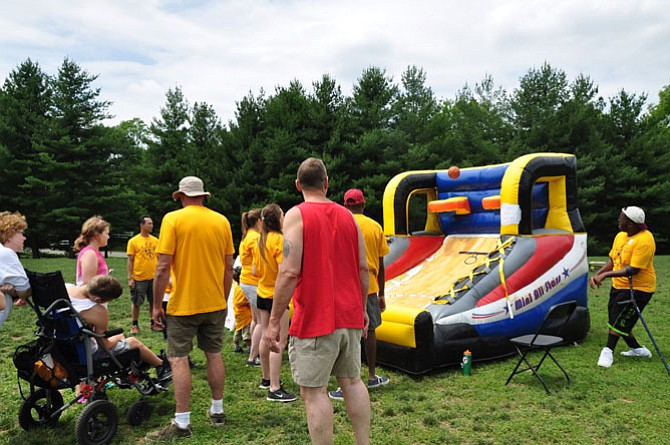 Volunteers teamed up with KEEN athletes for events such as tug-of-war, obstacle course challenges, kick ball, and volleyball on June 7 at Avenel Park.