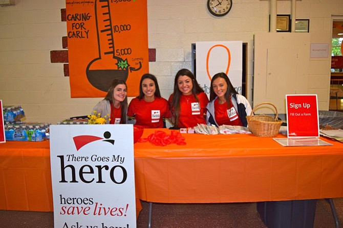 "From left, Holy Child students Jenna Parro, Maddy Schnider, Maddie Gessler and Kaylie Atwood participate in a ""Swab a Hero. Be a Hero"" event to recruit bone marrow donors."