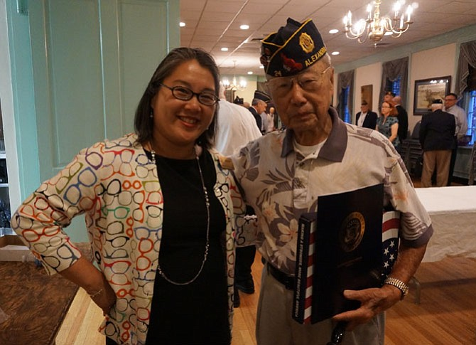 World War II veteran Col. Kim Ching (USAF, ret.) with Anh Phan, who presented Ching with a flag flown over the U.S. Capitol on behalf of Sen. Mark Warner. Ching, a past commander of American Legion Post 24, celebrated his 90th birthday May 25.